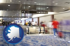 ak map icon and an airport people mover, with motion blur