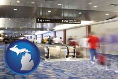 mi map icon and an airport people mover, with motion blur