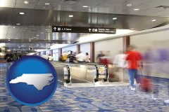 north-carolina map icon and an airport people mover, with motion blur