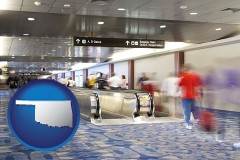 oklahoma map icon and an airport people mover, with motion blur