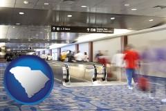 south-carolina map icon and an airport people mover, with motion blur