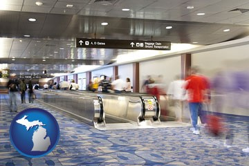 an airport people mover, with motion blur - with Michigan icon
