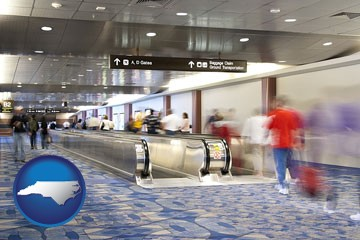 an airport people mover, with motion blur - with North Carolina icon